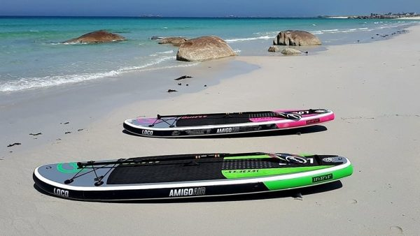 Green & Pink Loco Amigo Air iSUPs on beach in France